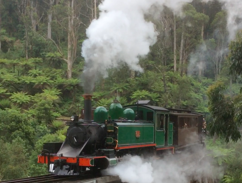 Puffing Billy steam train going over the trestle bridge